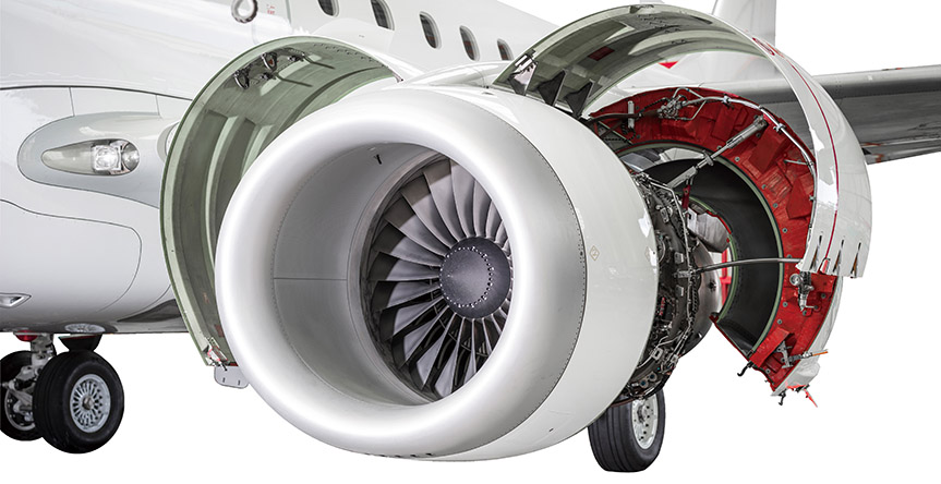 Open airplane engine in hangar